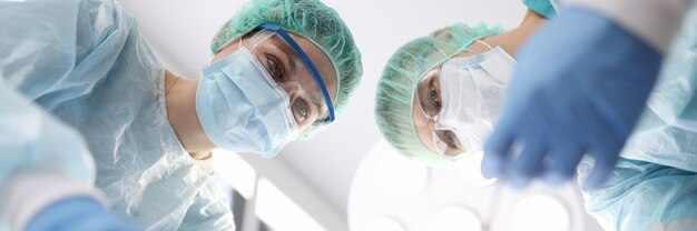 Group of doctors performing surgical operation in clinic