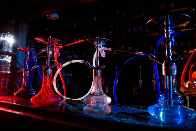 Group of eastern hookahs on table of a bar.
