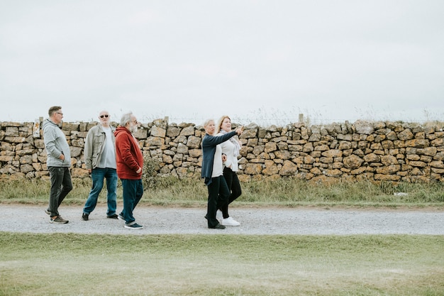 Group of elderly people strolling together
