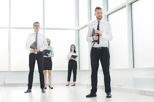 Group of employees waiting for the interview in the office lobby. the concept of career growth