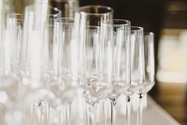 Group of empty and transparent champagne glasses in a restaurant.