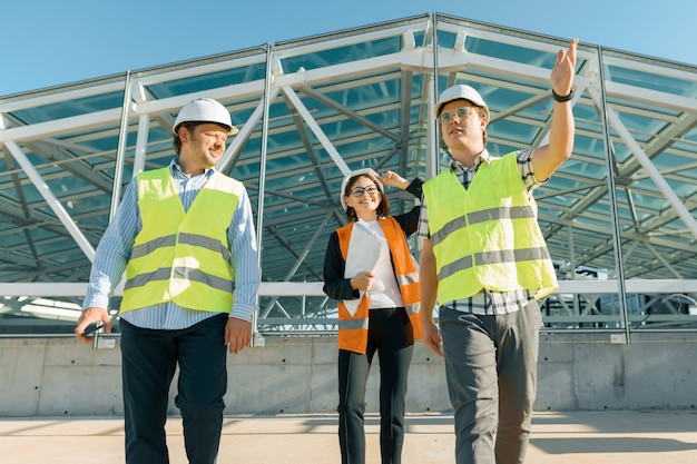 Group of engineers, builders, architects on the building site