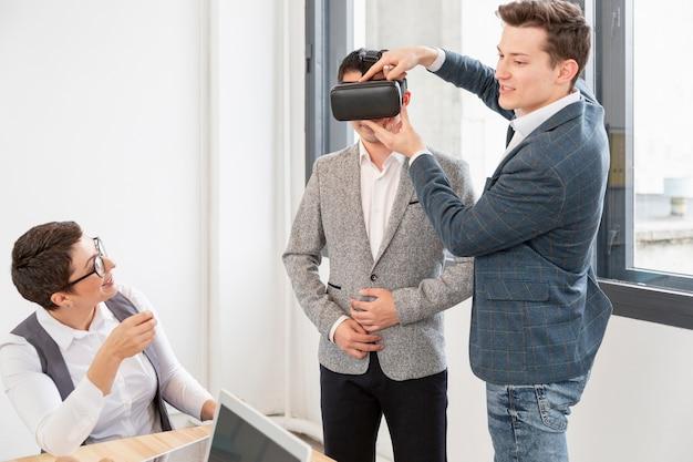 Group of entrepreneurs checking vr