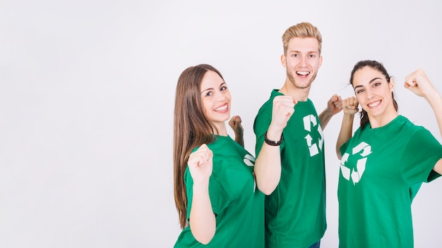 Group of excited friends standing on whit background