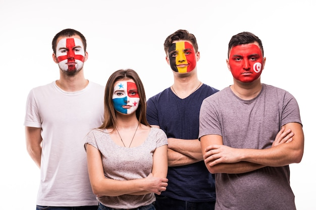 Group of fans suport their national teams with painted faces. england, belgium, tunisia, panama fans isolated on white background