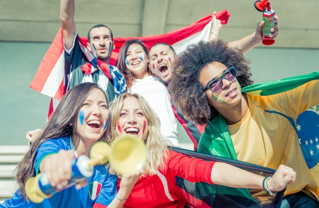 Group of fans supporting their team at the arena