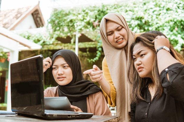 Group of female students having problems