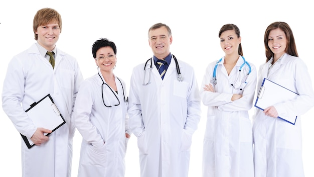 Group of five laughing successful doctors standing together