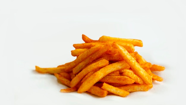 Group of french fried with paprika chilly powered on white surface
