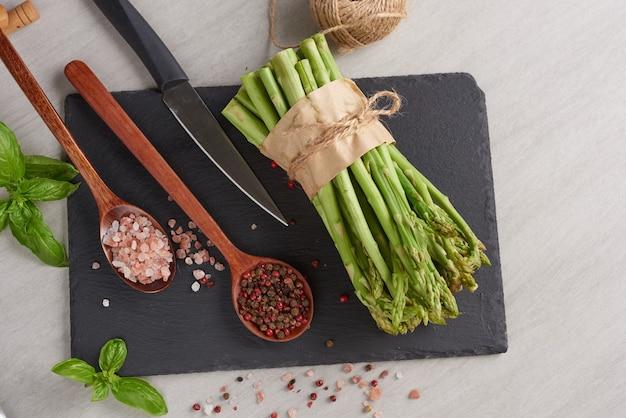 Group of fresh asparagus on wood surface