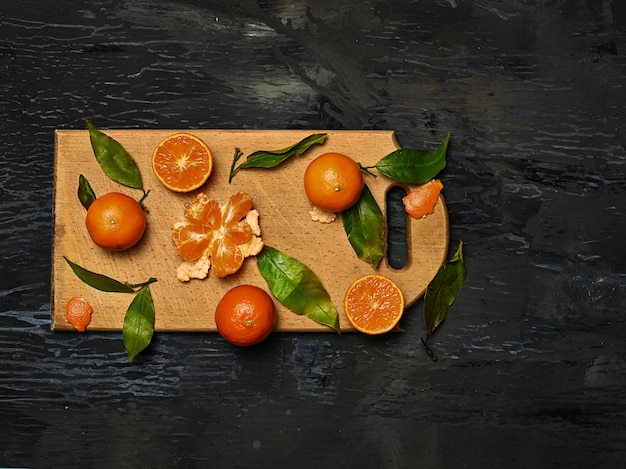 Group of fresh fruits on wooden board