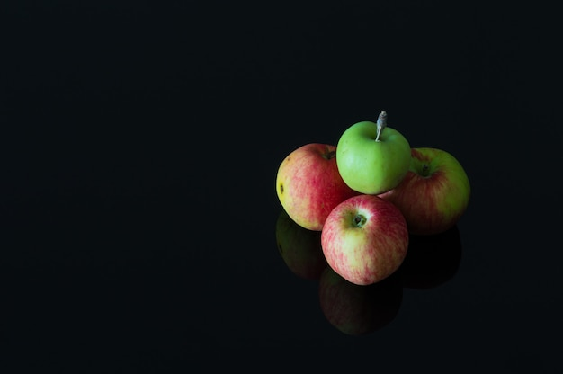 Group of fresh organic apples on a black background