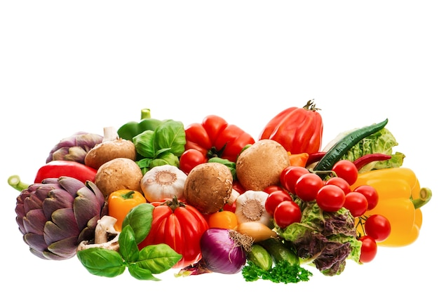 Group of fresh vegetables and herbs isolated on white background. raw food. tomato, paprika, artichoke, mushrooms; cucumber, green salad, basil