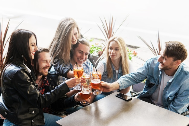 Group of friends are happy to see each other. celebrating meeting in the street bar.
