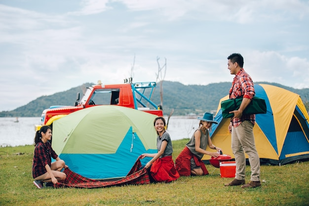 Group of friends asian camp forest adventure travel remote relax concept, mountain view.