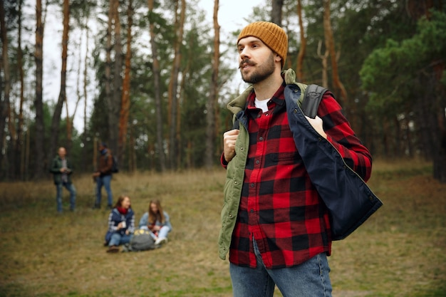 Group of friends on a camping or hiking trip in autumn day