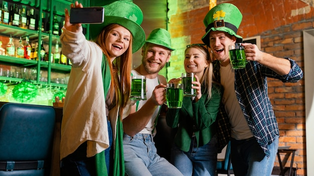 Group of friends celebrating st. patrick's day together