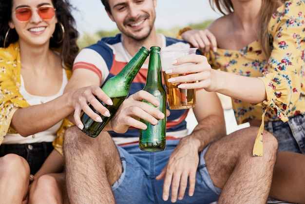 Group of friends doing celebratory toast with beer
