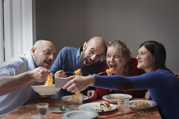 Group of friends eat pasta