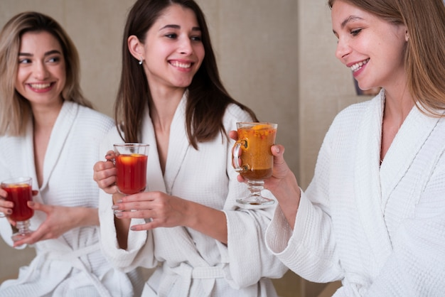 Group of friends enjoying drink at spa