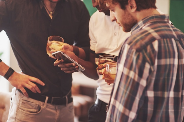 Group of friends guys with glasses of whiskey. concept party, bachelor party barbershop.