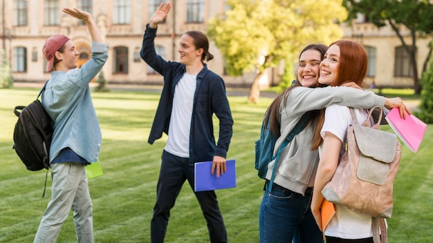 Group of friends happy to be back at university