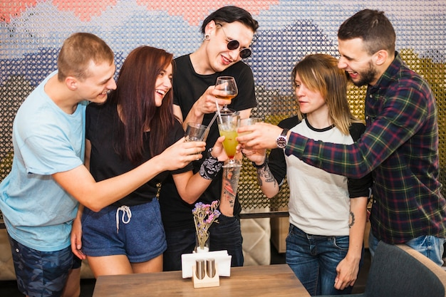 Group of friends having drinks in restaurant