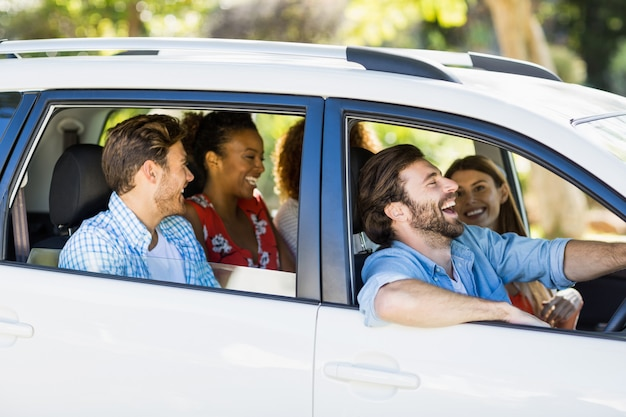 Group of friends having fun in car