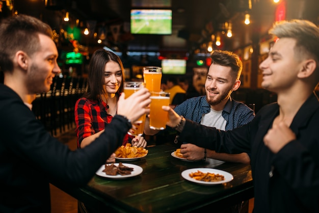 Group of friends having fun in a sport bar