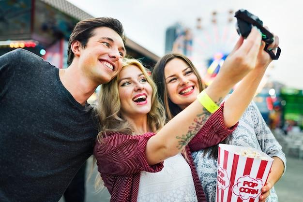 A group of friends is enjoying the amusement park