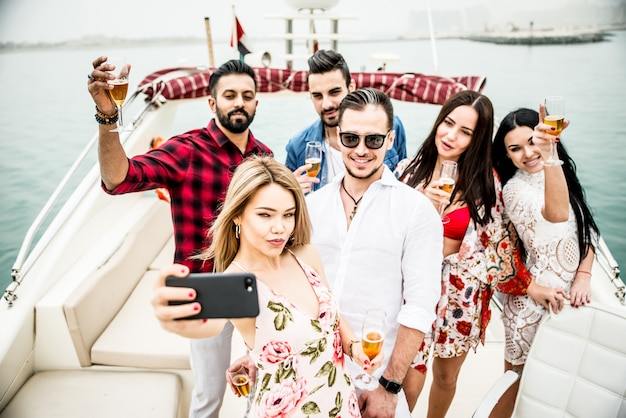 Group of friends making party on a yacht