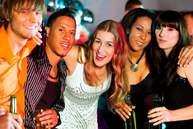 Group of friends in nightclub drinking
