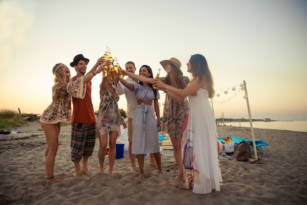 Group of friends partying at the beach