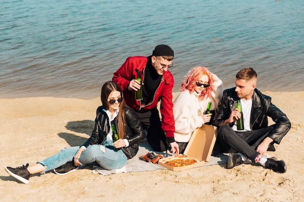 Group of friends on picnic at seashore