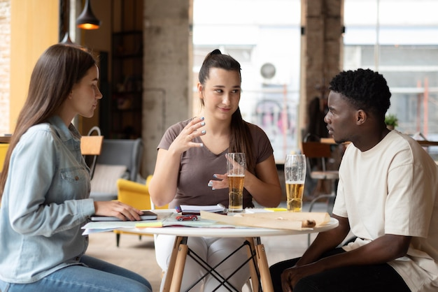 Group of friends planning a trip in a cafe