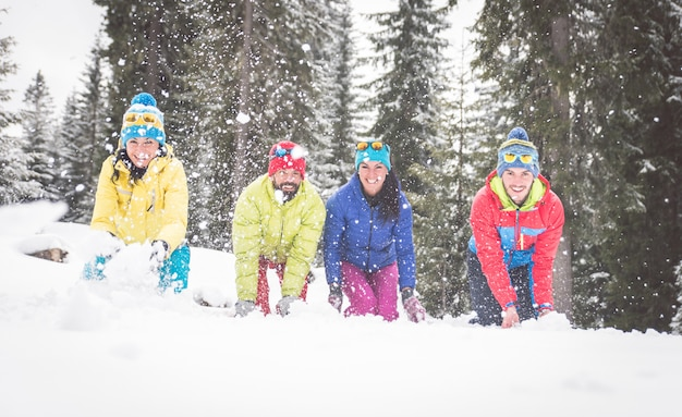 Group of friends playing in the snow