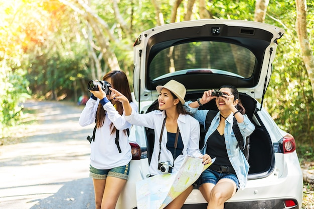 Group of friends taking on camping trip - summer, holidays, vacation and happiness concept
