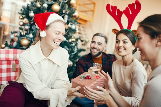 Group of friends toasting at christmas party