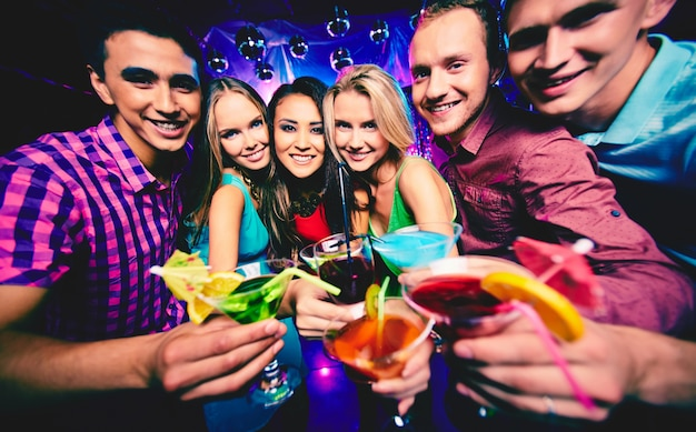 Group of friends toasting in the nightclub
