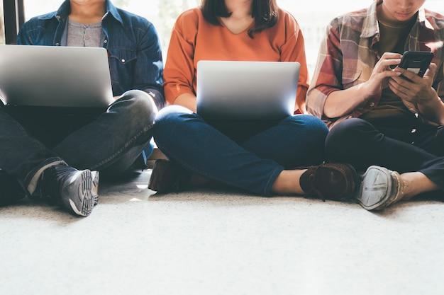 Group friends using modern gadgets.