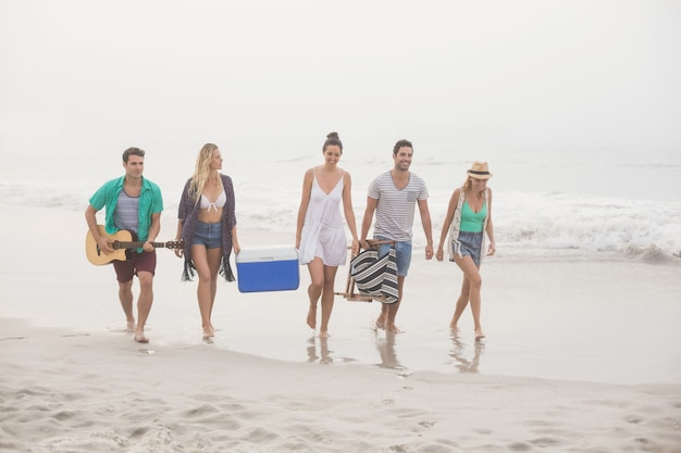 Group of friends walking on the beach