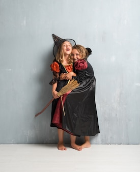 Group of friends with costumes of vampires and witches hugging