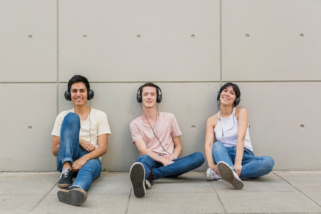 Group of friends with headphones on