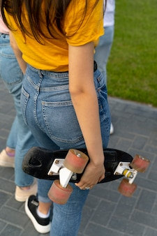 Group of friends with skateboard in the city