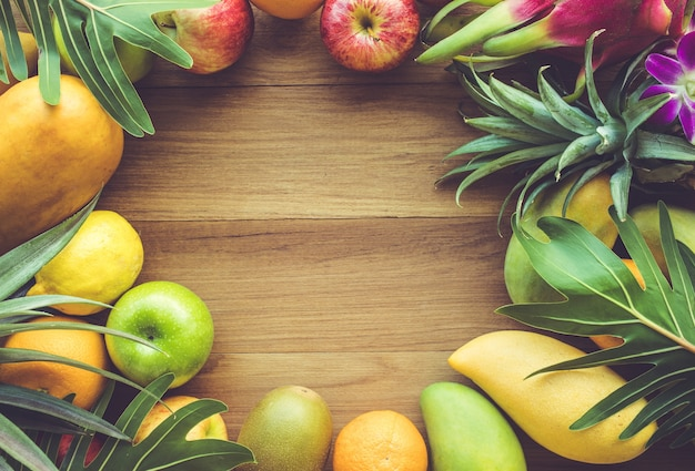 Group of fruits on wood table with copy space, flat lay