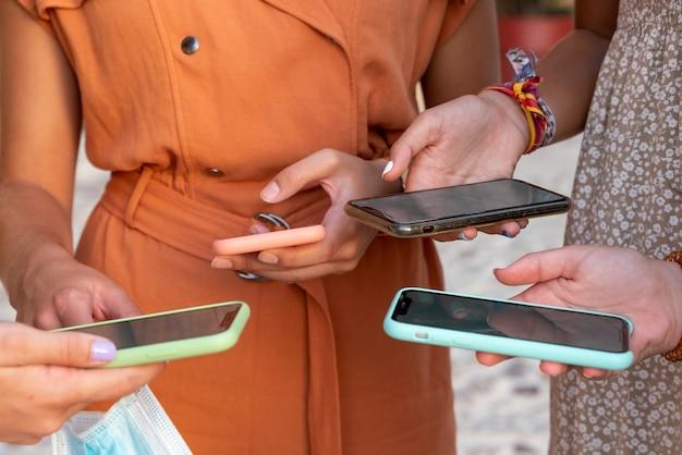 Group of girlfriends looking at their phones