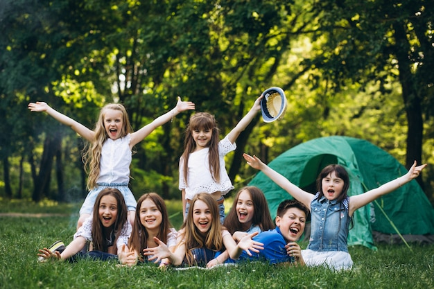 Group of girls camping in forest Free Photo