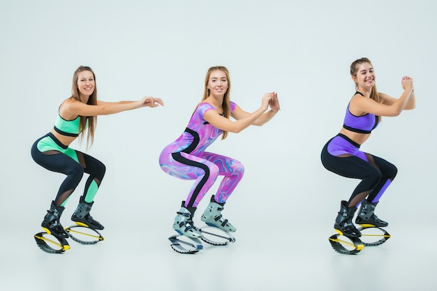 The group of girls, jumping on kangoo training