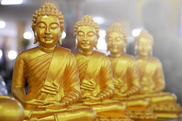 Group of golden buddha statue as temple. religions concept.