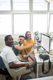 Group of graphic designers working on computer